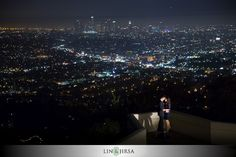 Ken really loves the composition of the shot and how it incorporates the beautiful LA backdrop. Cynthia agrees that it is beautiful, but that the couple gets lost in the shot. She prefers for the couple to be more of a focal point. Engagement Pictures, Engagement Shoots, Engagement Photography, Hollywood Glamour Wedding, Pregnancy Photos, Maternity Photos, Griffith Observatory, Renewal Wedding, Day And Mood