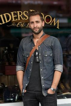 Denim. I love the complete look, including his hair and beard.