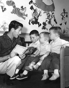 Johnny Carson reads to his sons.