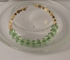"""Armbånd med krystaller og """"gull"""" perler"""