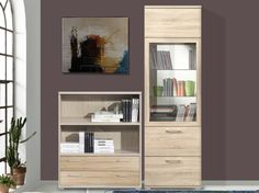 Rio at home Shelving unit (Oak) - This splendid shelving and display unit from Rio At Home in oak is highly functional to say the least!  It can be separated into two parts to make different looking units or can be used in different spaces in a home. Magnificient as it is, the storage is ample with a glass shutter to add to the modern feel. It also can be used to display showpieces and artifacts. This is definitely one to go for and make you fall for awe-inspiring German design!