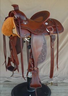 Made for an extreme cowboy competitor who wanted a saddle that would rise to all the demands of extreme cowboy competitions and look great doing it. $4200