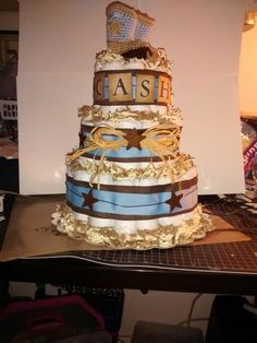 Cowboy Diaper Cake #woodstars #diapercake #western #babyshower #crochet #cowboyboots Vintage Diaper Cake, Diaper Cakes, Baby Boy Shower, Babyshower, Pink Blue, Shower Ideas, Westerns, Gift Ideas, Children