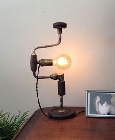 Upcycled Industrial Drill Lamp, repurposed desk table lamp by concepcion Pipe Lighting, Industrial Lighting, Cool Lighting, Industrial Pipe, Lighting Ideas, Cool Lamps, Unique Lamps, Lampe Steampunk, Luminaire Original