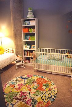 Not my favorite color scheme but I love that there's a day bed in the nursery!  So convenient!