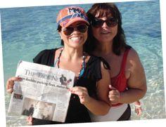 Shirley Coca and Danielle Watson soak in The Taos News in Falmouth, Jamaica!