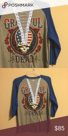 CCO SALE 🎉 Grateful Dead lace up tee 🌀This tee is made to order- meaning that it could take a few days to ship, and some variations may occur.   🌀If you notice any discoloration around the lacing, please just ignore it as it is only the photo, the tee will not look like that!  🌀Don't like something about the lacing or want to change the color? just ask!  🌀Price is FIRM. Absolutely NO trades.   🌀This is a handmade item that is similar to LF- listed brand is for views only. LF Tops Tees…