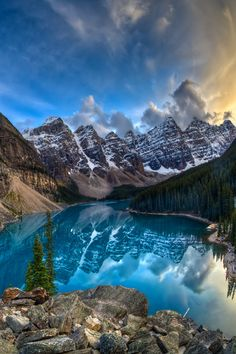 Moraine Lake, Banff National Park, Alberta, Canada by Chris Muir. Moraine Lake is a glacially-fed lake in Banff National Park, 14 kilometres (8.7 mi) outside the Village of Lake Louise, Alberta, Canada. It is situated in the Valley of the Ten Peaks, at an elevation of approximately 6,183 feet (1,885 m). The lake has a surface area of .5 square kilometres (0.19 sq mi). Moraine Lake, being glacially fed, does not reach its crest until mid to late June.