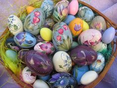 .What A Beautiful Easter Table Decoration!! Colored Eggs With Painted/Stenciled Patterns In A Bed Of Grass Inside a Beautiful Basket...Gorgeous, Festive & Waiting On The Bunny To Come
