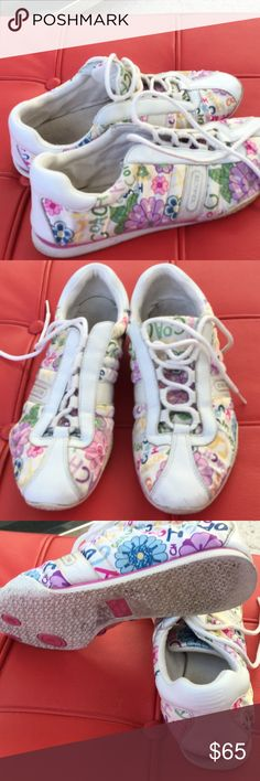 Spring Coach shoes, 7.5 Kindly worn flowered Coach athletic shoes, 7.5. Very clean except bottoms which have stains, not dirt. There is wear on bottoms but not severe. Coach Shoes Athletic Shoes