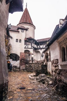 castles It was a cold, wet and windy day when our bus pulled into the bus stop directly below Bran Castle- an imposing fortress associated with Dracula. Transylvania Castle, Transylvania Romania, Beautiful Castles, Beautiful Places, Draculas Castle Romania, Places To Travel, Places To See, Dracula Castle, Romania Travel