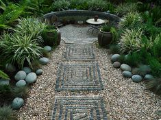 Stone elements and greenery along with a little retreat at the end of the path make for an appealing garden getaway.