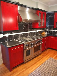 Stainless steel Wolf and Sub-Zero appliances complement the bold colors of this contemporary kitchen. Sub Zero Appliances, Kitchen Cabinets, Kitchen Appliances, Triangle Design, Kitchen Design, Kitchen Ideas, Bold Colors, Countertops, Dream Kitchens
