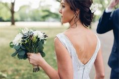 A beautiful bride and her simple yet elegant posy bouquet. Image credit: Boho Belle Makeup & Hair