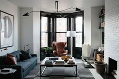 a bachelor in Brooklyn, black and white stripped rug, Serge Mouille ceiling light, Cassina chair, Egg chair #EggChair