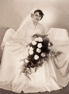 Stunning Bridal Portrait taken in 1955 in Germany. Love the bodice on this gown.