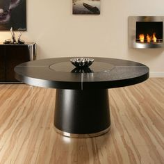 Truly stunning AG Design CT3706 large round dining table in black oak. Special features include aluminium trim and central and revolving glass section (lazy susan). Beautifully crafted and will comfortably seat up to 8. Please call on 024 7664 2139 or email sales@quatropi.com for details. Supplied with subtle LED lighting feature under the lazy susan glass with remote control that changes the LED colours/light pattern.
