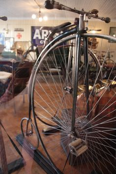 A penny farthing bicycle, seen at the Beamish Museum's 1900s Town garage.  County Durham, UK