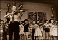 The Suzuki method is centered around creating the same environment for learning music that a person has for learning their native language. This 'ideal' environment includes love, high-quality examples, praise, rote training and repetition