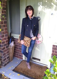 Jane from My Midlife Fashion and her favorite animal print clutch.