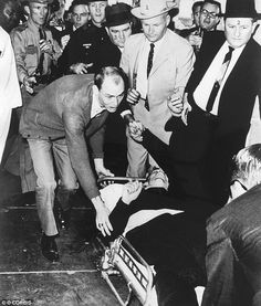 24 Nov 1963, Dallas, Texas, USA --- Lee Harvey Oswald lies on a stretcher after being shot by Jack Ruby during a press conference two days a...