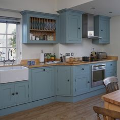 Like the blue/gray cabinets with the wood counter.