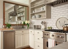 huge mirror in kitchen - GREAT idea! makes a small kitchen twice as large