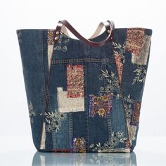 The Denim Collection tote is handcrafted from upcycled Chico's brand embellished denim jacket.