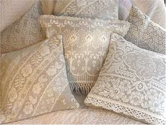 Pretty lace pillows. Idea - stencil doily or lace on plain fabric, then sew up into pillows.