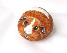 Guinea pig painted on a stone. Will be sent in a gift box.