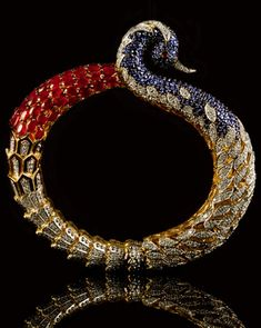 Jewellers choice design awards Mumbai India, Peacock bangle set with various gemstones and diamonds