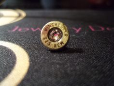 Bullet casing Tie/Lapel pin with Silk Swarovski crystal. $20.00.