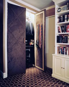 man's closet with upholstered doors with nail head detail