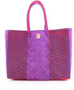 It's not crocheted (it's woven plastic) but I still really, really like it.   (Joie Louisa Woven Tote in Purple)