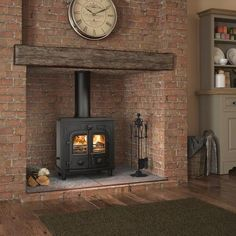A stunning black metal centrepiece in a rustic environment - the Hercules 20 is the quintessential design of a stove. With just sit back and watch this multifuel stove burn your coal or wood. Boiler Stoves, Stove Accessories, Multi Fuel Stove, Electric Stove, Log Burner, Gas Stove, Centre Pieces, Beams, Home Appliances