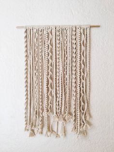 "24"" across and 33"" long.(Includes the wooden dowel rod) 100% natural cotton cord Each wall hanging is made by me I also do custom orders"