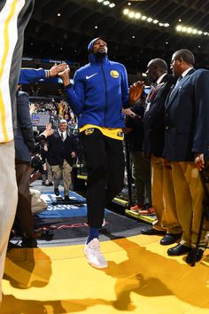 Kevin Durant of the Golden State Warriors makes his entrance before the game against the Milwaukee Bucks on March 29 2018 at ORACLE Arena in Oakland...