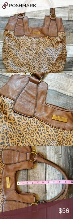 JESSICA SIMPSON cheetah print hobo Faux leather cheetah print bag with tan trim and straps. Roomy interior and snap closure. AntiqueGreat condition Jessica Simpson Bags Hobos
