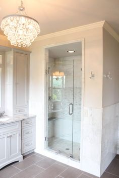The light fixture and tile in this bathroom are to die for!