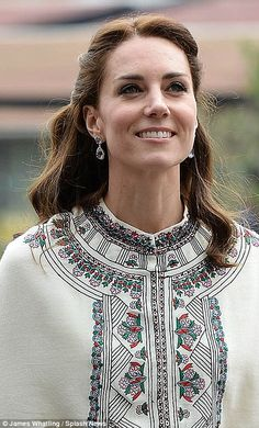 Naturally Kate wore her diamond and sapphire engagement ring, but a large pair of diamante drop earrings added an extra element of sophistication