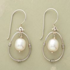 "PENDULUM PEARL EARRINGS  Item No. 45712	 $48.00 Our handwrought sterling silver earrings with winsome white pearls swoon and sway to mesmerizing effect. Exclusive. 1-3/8""L."