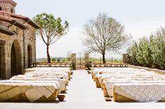 Unique and budget friendly seating for an outdoor wedding. Hay bales covered with lace and linen.