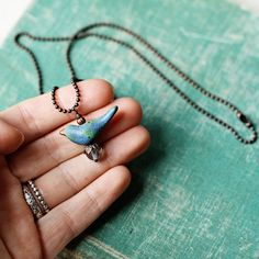 Blue Earth bird necklace handmade by kylieparry on Etsy, $22.00