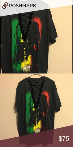 CCO SALE 🎉 Bob Marley lace up tee 🌀This tee is made to order- meaning that it could take a few days to ship, and some variations may occur.   🌀If you notice any discoloration around the lacing, please just ignore it as it is only the photo, the tee will not look like that!  🌀Don't like something about the lacing or want to change the color? just ask!  🌀Price is FIRM. Absolutely NO trades.   🌀This is a handmade item that is similar to LF- listed brand is for views only. LF Tops Tees…