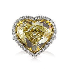 A natural beauty like this fancy yellow heart shaped diamond is incredibly rare. The massive stunner is and is GIA certified at Fancy Yellow, Heart Shaped Engagement Rings, Top Engagement Rings, Buying An Engagement Ring, Designer Engagement Rings, Best Diamond, Diamond Cuts, Diamond Anniversary Rings, Heart Shaped Diamond, Wedding Rings Vintage