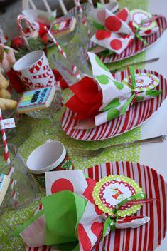 A Little Loveliness Xmas table scape. Using tissue paper and red and green plastic silver wear and holiday mugs