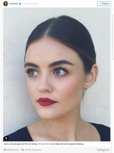 The classic red lip combined with feathery lashes = perfection