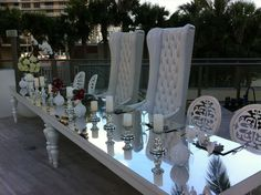 Chic and modern bride and groom's table at the St.Regis Bal Harbour with our Royal tables, Marie Antoinette chairs, Crystal Medallion chairs and chic accents!