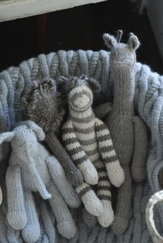 baby knits - soft blanket and animal friends- I LOVE how whimsical these animals are- They are almost like a freeform- especially the long necked llama?giraffe?I want to make a dozen of these!