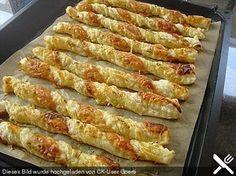 Käsestangen aus Blätterteig, ein raffiniertes Rezept aus der Kategorie Kalt. Bewertungen: 17. Durchschnitt: Ø 4,7.